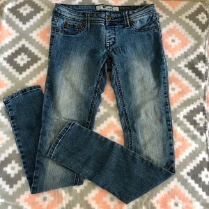 Wet Seal Stretchy Faded Skinny Jeans faux pockets